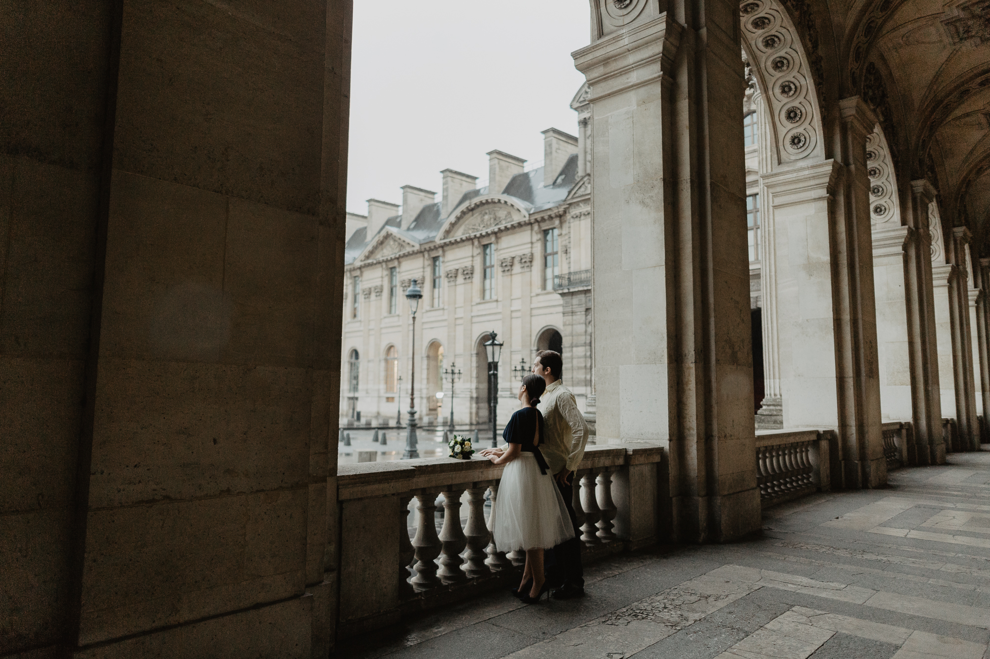 Couple in the rain Louvre Museum Paris Photography