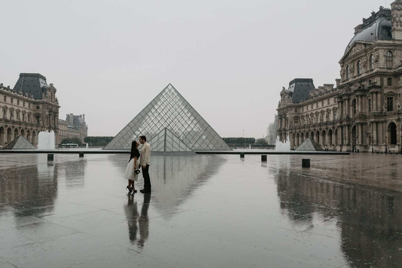 Couple in the rain Pyramid Louvre Museum Paris Photography