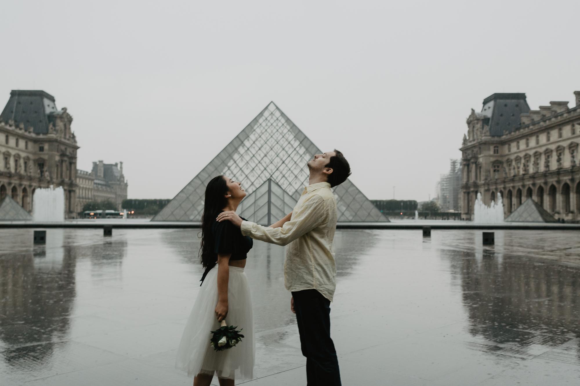 Couple under the rain Pyramid Louvre Museum Paris Photography