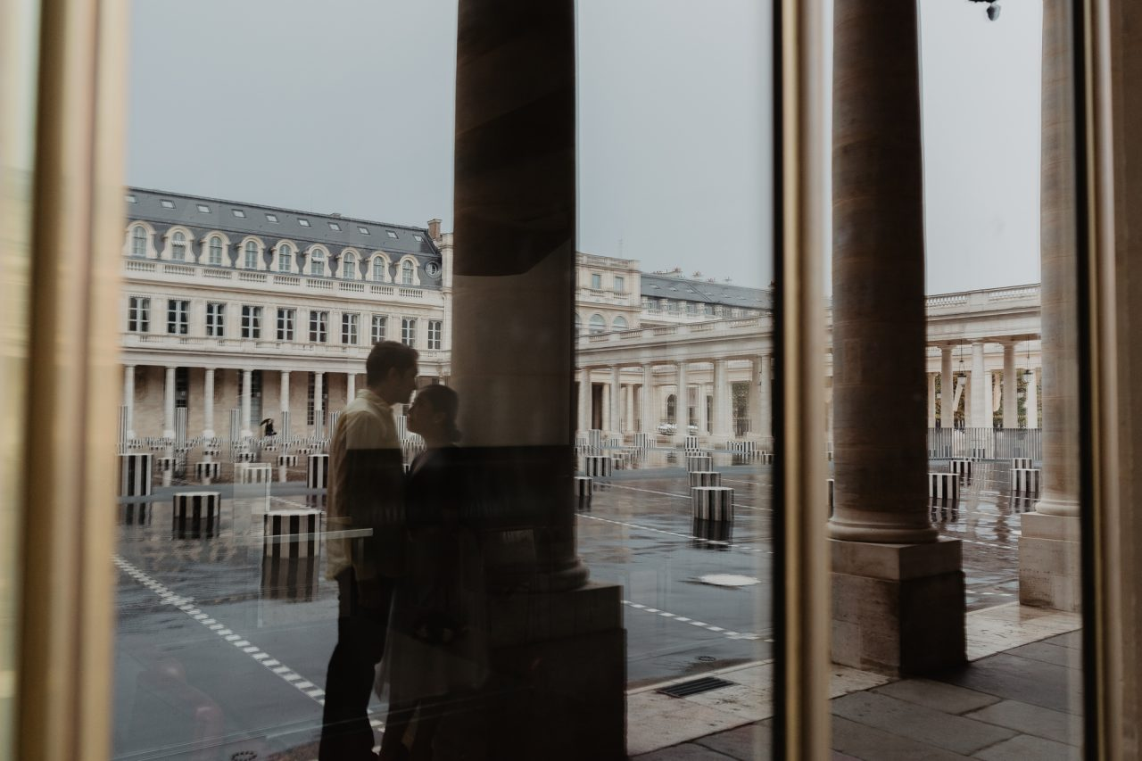 Couple reflection Palais Royal Paris