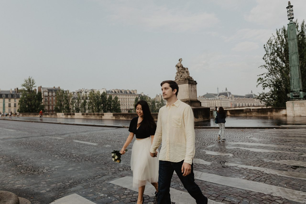 Couple photography crossing street Seine river Paris