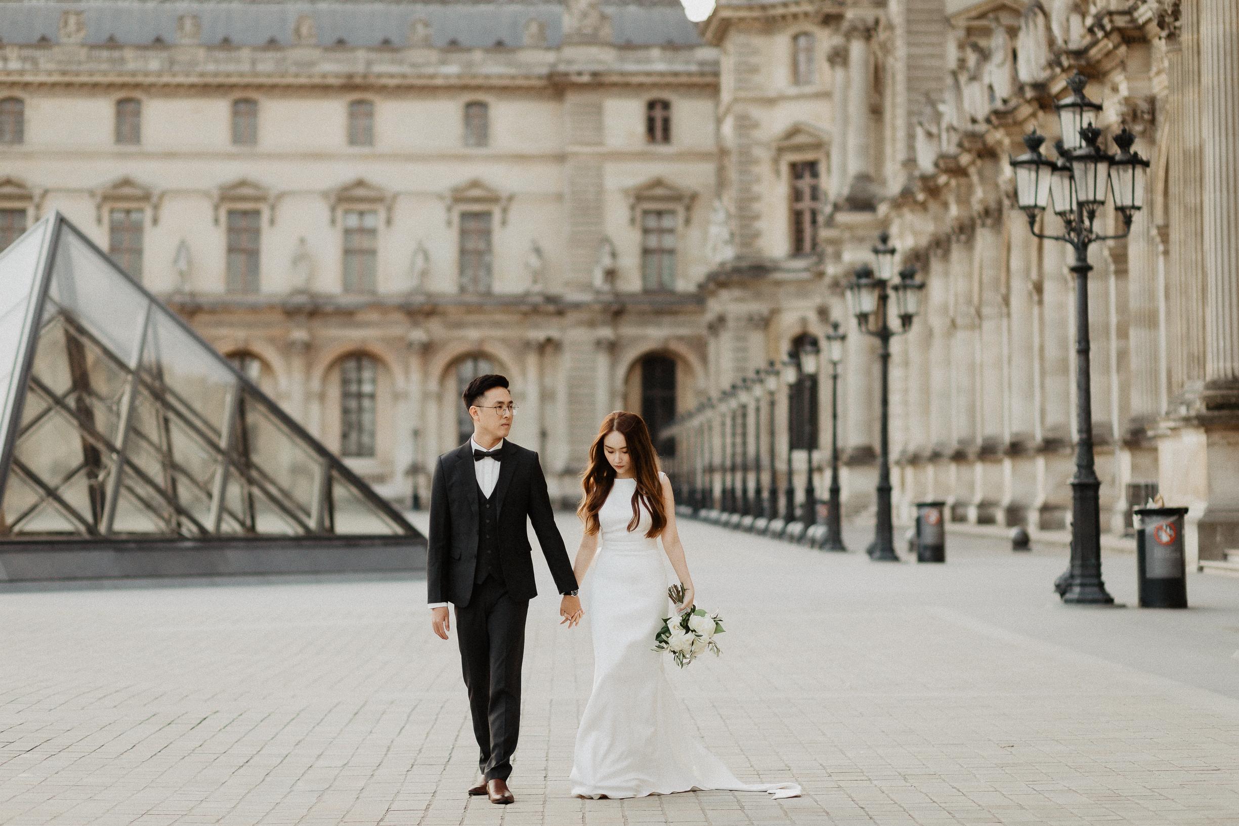 paris engagement pre-wedding photoshoot louvre bride groom flowers