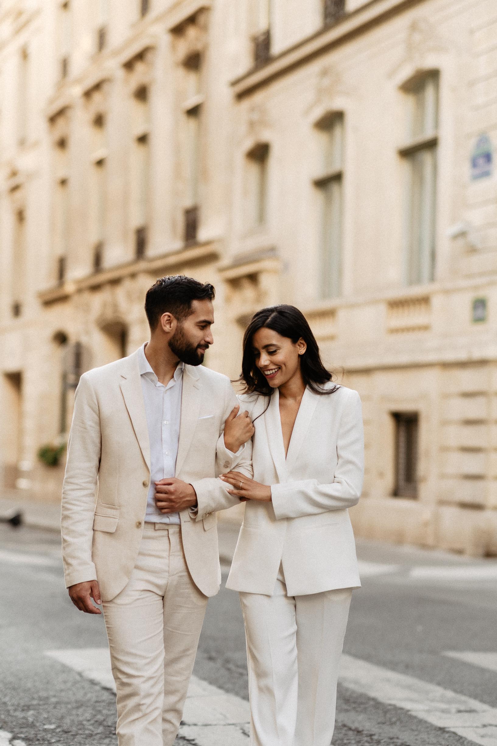 Couple wearing suits paris photographer