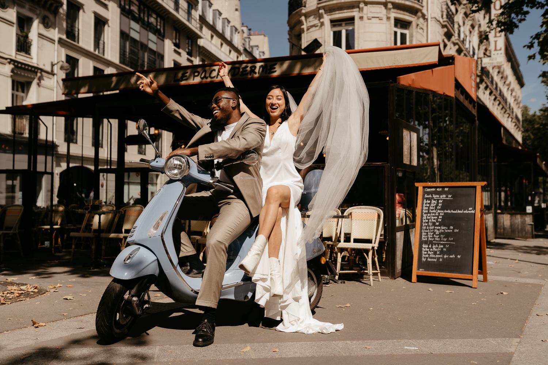 paris wedding with blue vespa mixed couple