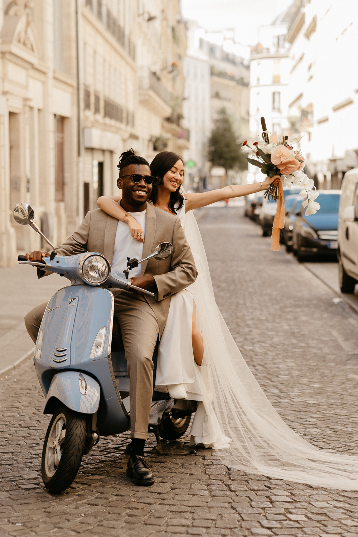 paris elopement photographer with blue vespa