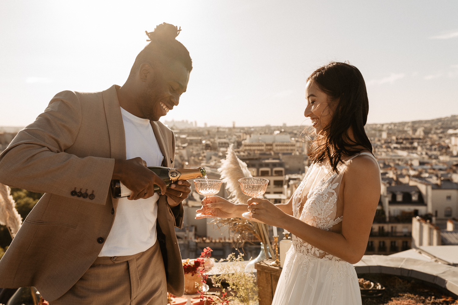 elopement celebration paris rooftop with mixed couple