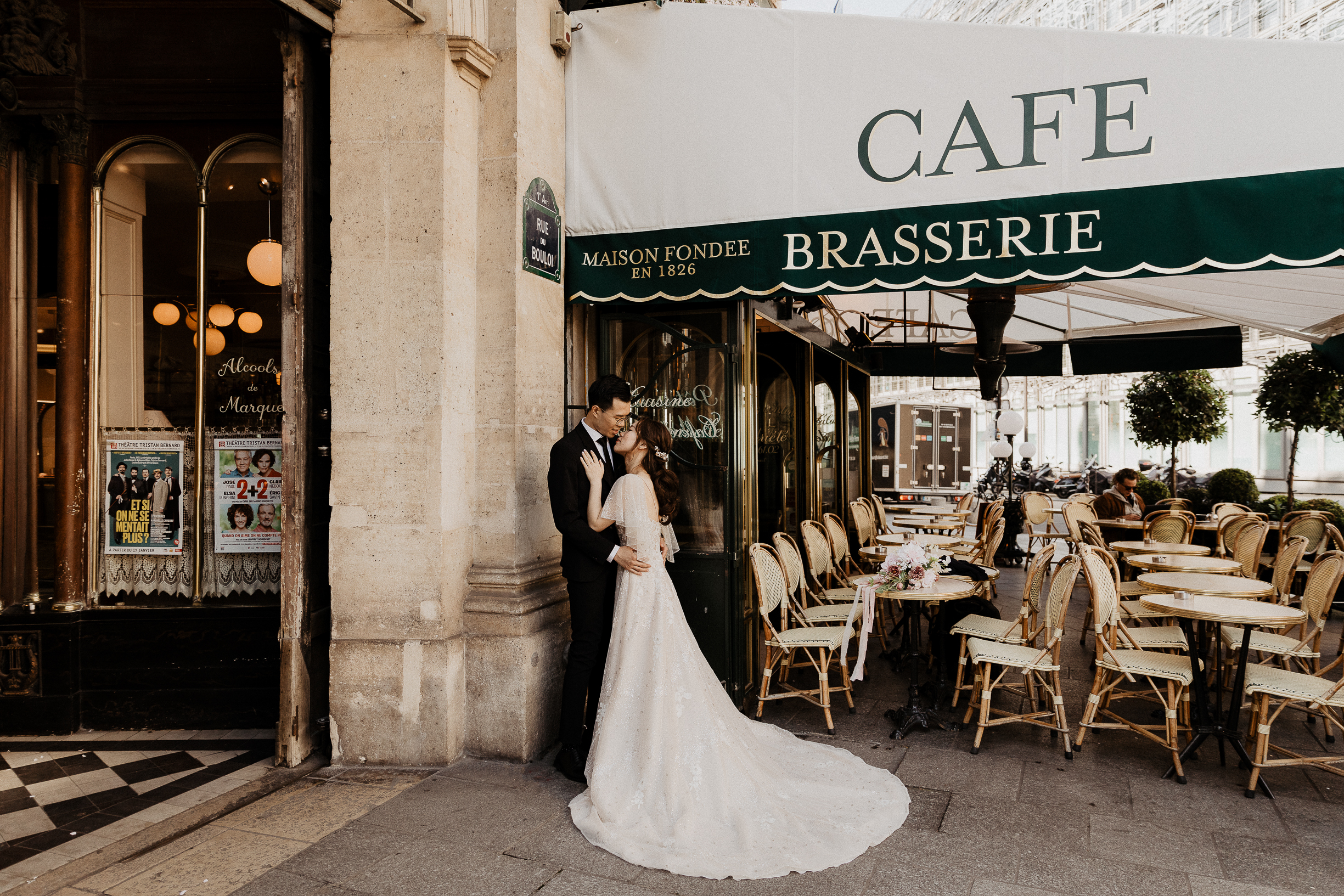 Bride and groom at a cafe in Paris