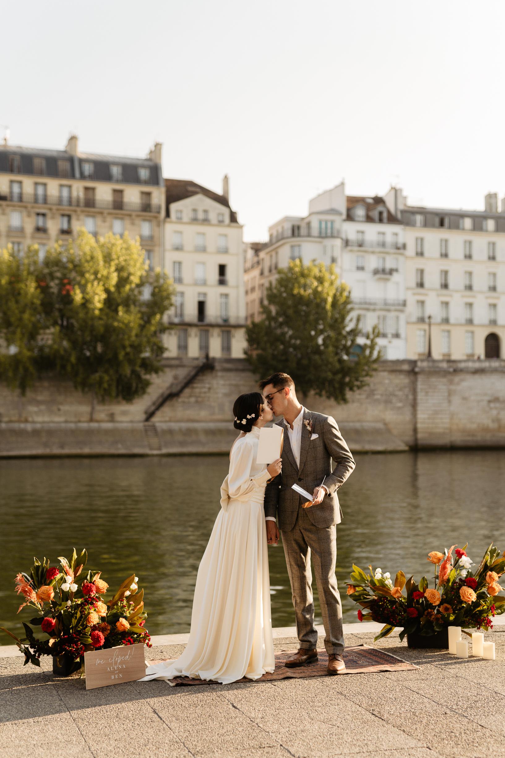 Paris Wedding & Elopement photographer couple photoshoot by the seine with flower bouquet