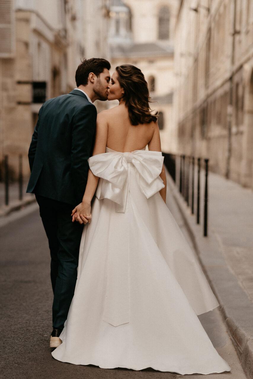 Paris wedding photography stylish bride with big bow wedding dress