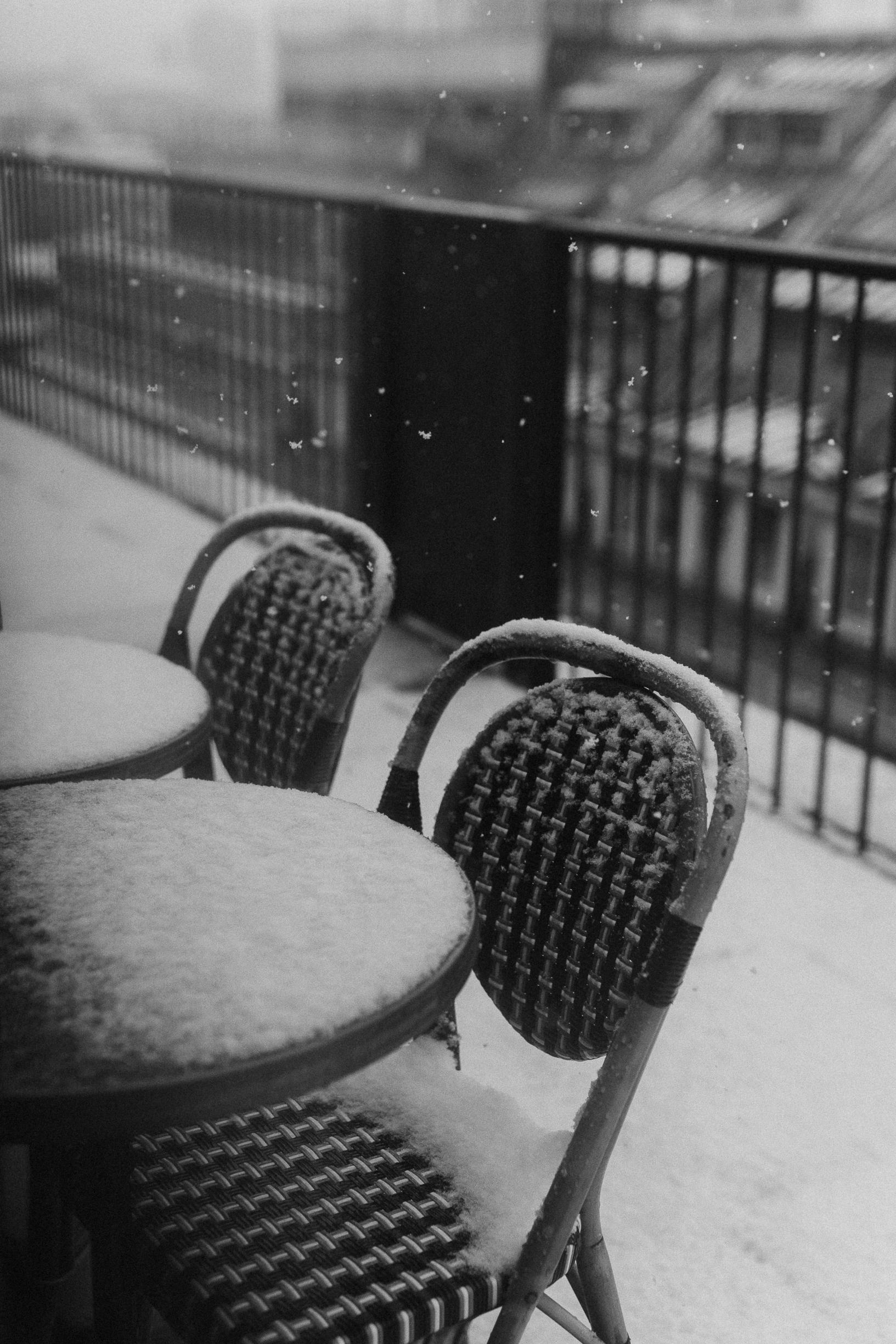 Snow in paris winter cafe