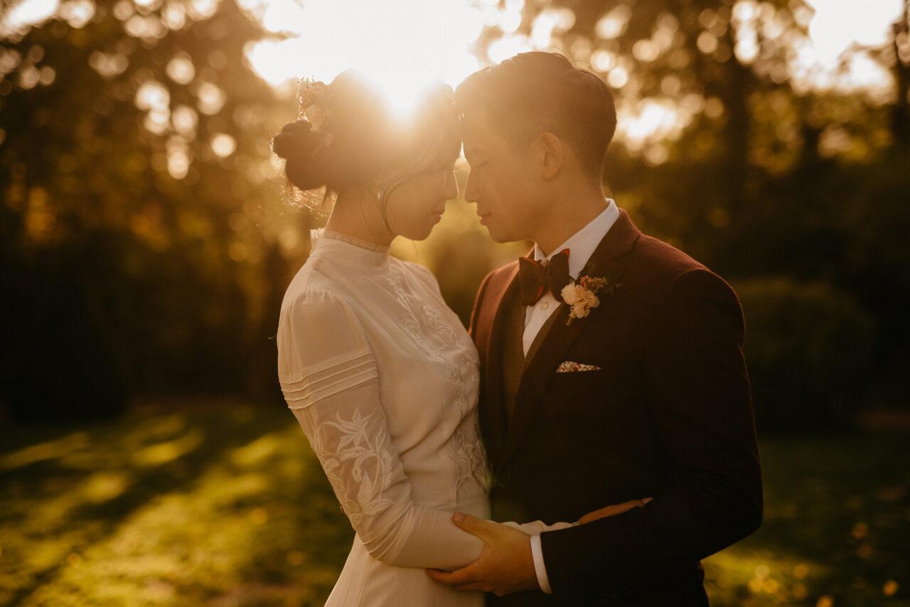 couple wedding photoshoot touching moment