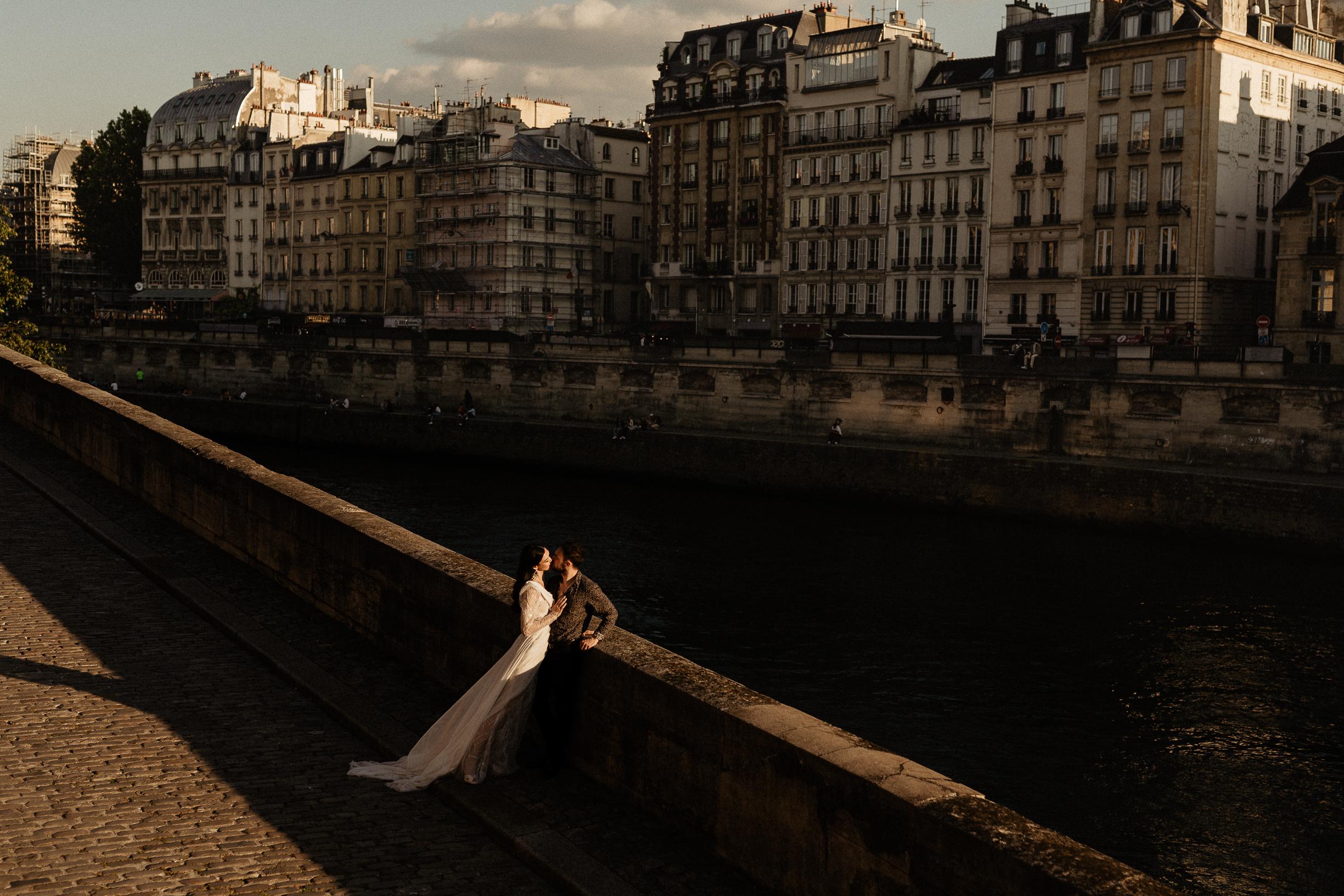 Paris couple photo by seine river